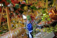 People visit the colourful Schonbrunn Ostermarkt, or Easter Market, in Vienna, Austria, on March 27, 2013.