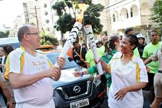 UN Women Executive Director received the Olympic Flame from Prince Albert of Monaco and carried it through the streets of Rio de Janeiro, celebrating women's and girl's empowerment.She handed the Flame to Thiago Firmino, a renowned community activist and favela tour guide at Morro Santa Marta, Brazil. Photo: UN Women/Gustavo Stephan