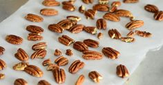 How to Toast Pecans in the Oven: Preheat your oven to 300F. Line a baking sheet with parchment paper and arrange raw pecans (halves or pieces) in a single layer. Bake for 15-20 minutes, until nuts are evenly toasted. You can check by cutting a nut in half to see that the color inside is uniform. The nuts will seem slightly soft when hot, but will firm up as they cool. Store cooled nuts in an airtight container.