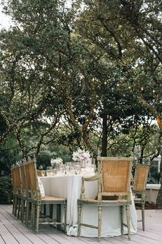 a summer evening with a white tablecloth & antique cane chairs
