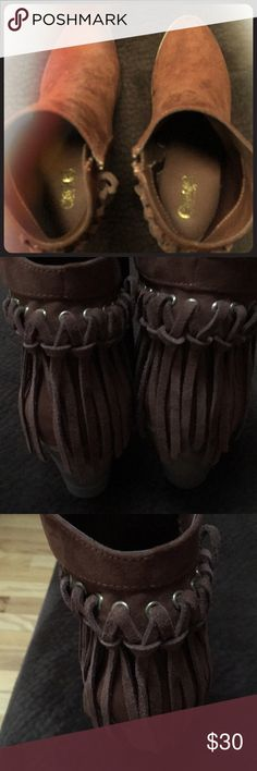 Carlos Santana ankle fringe boots size7.5 Omg I love these boots but I never worn them didn't even knew it had it sitting in my closet the boots sole has flower motives fringes nice brown color I bought them from Marshals 2 years ago Carlos Santana Shoes Ankle Boots & Booties
