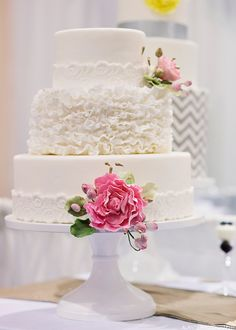 Beautiful Frilly White Cake with Pink Flowers