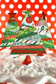 With some green cardstock, washi tapes, and a few other supplies (including chocolate kisses!), your kids can whip up these adorable Christmas tress, to use as gift toppers, table decor or tree orn…