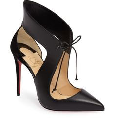 Airy cutouts and a dainty tie closure add impeccable finishing touches to this sleek and sophisticated pointy-toe pump by Christian Louboutin.