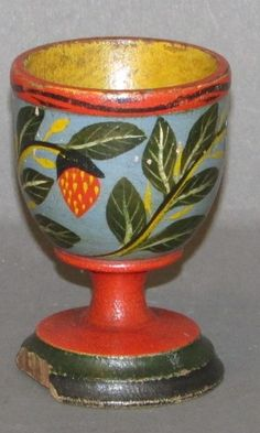 """541A_ 541A. Lehn egg cup ca. 1860-80; rare blue ground with strawberry decoration and yellow painted interior attributed to the shop of Joseph Lehn, 1 ¾""""x 2 5/8""""; Estimate $200.00-$300.00 SOLD FOR: 350.00"""