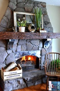 I love this homey fireplace you can put simple additions up to make it look more spring time like tulips and other natural plant elements | funky junk interiors