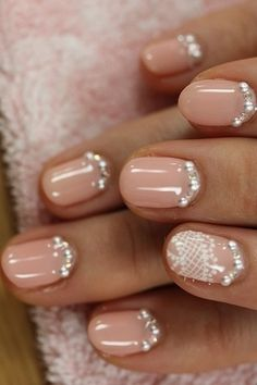 Rhinestone nail beds with lace accent nail, all on top of a sweet light pink polish