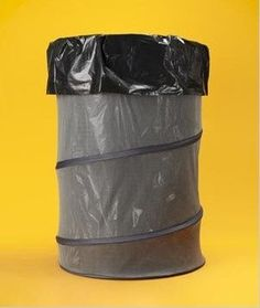 Camping Hack: Use a collapsible laundry bin as a garbage bag holder. Would work great if you could stake it down