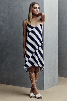Just one glance at this striped slip dress makes us dream of striped umbrellas at the beach and nautical adventures. #newlook #DiscoverSS16