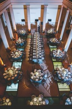 A mix of round and rectagular tables. Modern art museum wedding reception | photography by http://www.rebekahjmurray.com/ #table #layout #wedding #event #reception