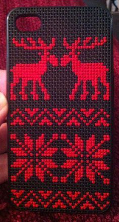 Moose/reindeer sweater cross stitch iPhone case. Intended to have one more row of design at the top but left it off due to timing.