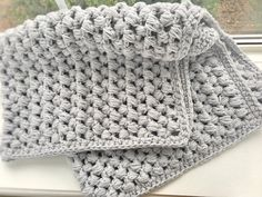I am so excited to share this pattern with all of you!  I wanted to make a big, squishy baby blanket and I must say... mission  accomplished. This comfy blanket is easy to make and works up pretty  quickly. Great project for new and experienced crocheters alike!  I hope you all enjoy the patte