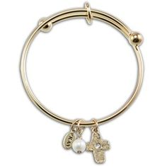 A great accessory for a First Communion dress, and a subtle reminder of faith. Adjustable bangle.