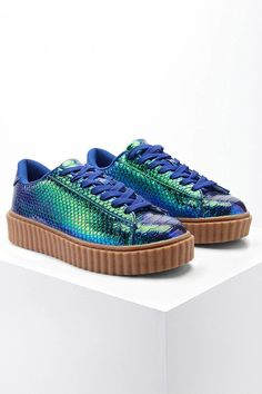 A pair of textured faux leather sneakers featuring a two-tone design, lace-up top, and a contrast ridged platform midsole. This is an indepedent brand and not a Forever 21 branded item.