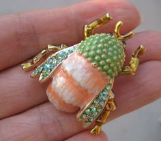 Gorgeous Colorful Bug Pin Brooch - Pack of 10 by Brooch Collection by VenusDesigns. $29.99. This is a rare bug costume jewelry piece. Its wings are embedded with AB green genuine crystal rhinestones. The smooth finish of the body and head colors and the arrangement of green genuine rhinestones match well on this bug pin brooch. Metal setting is in antique brass tone. It is attached with a securely safe pin closure.