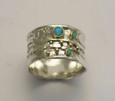 Sterling silver ring, gemstones band,  silver with yellow gold ring, blue opal ring, mixed metal band, wide silver band  -  Dreamy. by artisanlook on Etsy https://www.etsy.com/listing/85515126/sterling-silver-ring-gemstones-band