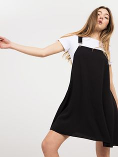 our black swing dungaree dress is a chic update on the 1970s fashion staple. metallic hardware provides that all important attention-to-detail, while the billowy shape falls flatteringly over the body. style with a white crop top underneath for monochrome impact, or introduce contrasting patterns into the mix, such as seasonal favourite - stripesmain fabric. 96% polyester 4% elastaneitem no. 70522