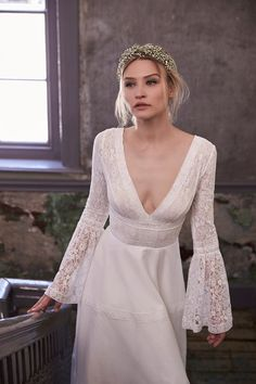 Beach wedding dresses   perfect for a destination do. Flared sleeve lace wedding dress by Sassi Holford (BridesMagazine.co.uk)
