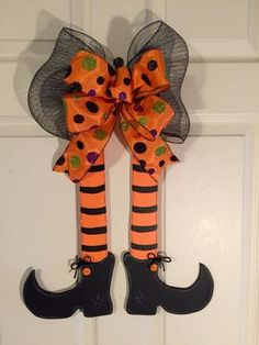 Our cute witch legs is approximately 22 long x 15 wide, including bow. Halloween Crafts To Sell, Dulceros Halloween, Moldes Halloween, Halloween Mesh Wreaths, Halloween Door Hangers, Manualidades Halloween, Adornos Halloween, Diy Halloween Decorations, Holidays Halloween