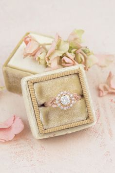 A romantic take on a classic 14k rose gold vintage inspired halo ring. Delicate diamonds, each in their own bezel accented with subtle milgrain engraving, surrounds this beauty. Petite leaves adorn the sides and appear to hold up the setting. So very sweet and feminine. | roughluxejewelry.com  #floralring #uniqueengagementring #vintagehaloring #rosegoldring #floralengagementring #fairytalering Vintage Inspired Engagement Rings, Floral Engagement Ring, Rose Gold Engagement Ring, Art Deco Wedding, Diy Wedding, Wedding Ideas, Vintage Ring Box, Queen, Halo Rings