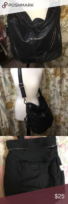 """Lucky Brand Distressed Hobo 100% Lamb Italian Leather. Bag is well loved and has a small tear which is pictured. Not very noticeable though. Silver hardware is intact, but distressed as well. Super soft leather, has a long life ahead and will only gain more character! Has a side pocket, 2 pockets inside and zipper closure. Measurements are: 14"""" tall, 12"""" Wide, 8"""" across bottom. Strap adjustable from 7"""" - 20"""" Lucky Brand Bags Hobos"""