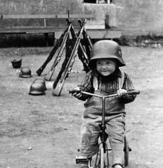Baby play with a German helmet