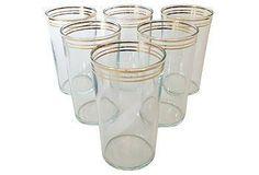 Set of six charming gold-rimmed juice glasses.