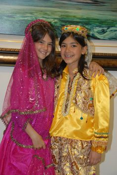 Happy Persian Girls in beautiful traditional Dresses.