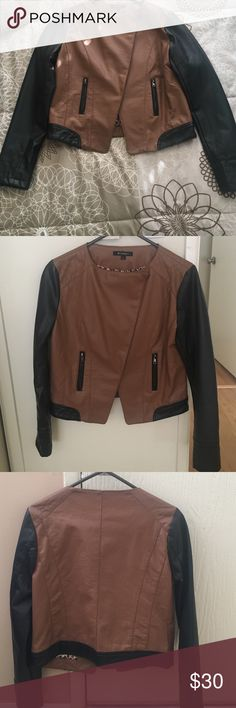 Leather jacket Brown and black leather jacket, size Large, I normally wear Medium but the Large fits me perfectly. No visible flaws in great conditions, used. Inside it has cheetah print. Jackets & Coats