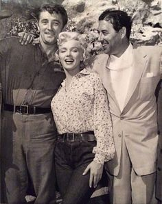 "Marilyn with Robert Mitchum and Herman ""Turk"" Prujansky on the set of River of No Return, 1953."