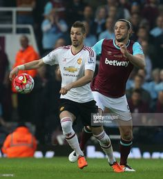 Morgan Schneiderlin of Manchester United in action with Andy Carroll of West Ham United during the Barclays Premier League match between West Ham United and Manchester United at the Boleyn Ground on May 10 2016 in London, England.