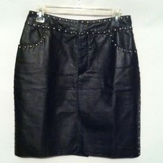 Black Leather Skirt with Metal Stud Detailing Gorgeous black leather skirt in excellent condition. Metal studding along sides, pockets and front waistband. Hook and eye closure with zipper in front. Fully lined. 27 inch waist and 20 inches long.  Leather is really soft on this skirt. Tower Hill Skirts