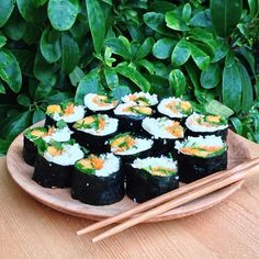 "Raw vegan papaya sushi rolls for lunch today.  The recipe is from raw food chef Megan Elizabeth's YouTube channel ""EasyToBeRaw"".  Just nori wraps filled with papaya, cilantro, carrot, cucumber, scallions,  a garlic-lime-ginger-cauliflower ""rice""!"