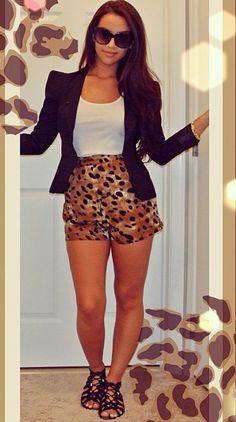 White tank, black blazer, leopard shorts and black sandals.