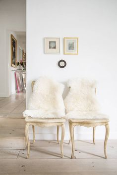 Inexpensive sheepskin rugs from IKEA serve as stylish throws for chair backs and sofas