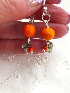 Items similar to Orange Fruit Green Lampwork Glass Dangle Earrings Doodaba on Etsy Orange Earrings, Silver Earrings, Drop Earrings, Orange Fruit, Green And Orange, Orange Crystals, Art Deco Necklace, Art Deco Wedding, Handmade Items