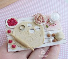 A set of miniature food  cooking dumplings with cherries.1:12