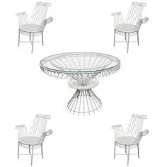 MATHIEU MATÉGOT model « Cap d'ail » white dining set with table and four armchairs.