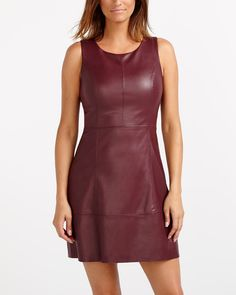 Spice up your wardrobe with this sleeveless Faux Leather Scuba Dress. With a modern design and trendy hue, it flatters the silhouette wonderfully. Pair this dress with stiletto booties for a chic and sexy look.<br /><br />Ready to wear for: a party, work, lunch with girlfriends