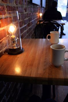 brick walls and lanterns on table //Northwest Coffee House in Portland, OR. I would LOVE to go there!