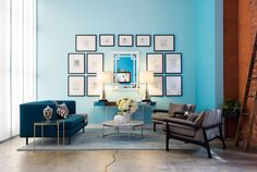 A gallery wall above a seating area at Jessica Alba's Honest Company office.