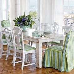 Like slipcovered end chairs with matching cushions on the side chairs