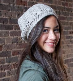 Crocheted by hand in soft, warm wool, this slouchy hat adds texture and flair to your winter getup. The open lace pattern circles the entire beret, radiating from the center of the crown. Wear it jauntily tilted to the side, pulled down low or slouched back for different looks.