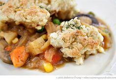 """vegetable cobbler- sauté and simmer them into a thick vegetable stew, pour the stew into a baking dish, and top it with mounds of herbed biscuit dough. When the cobbler comes out of the oven, that biscuit topping is golden and crusty on top, but underneath, it's drinking in all of that vegetable gravy.  Fill up your bowl for a one-dish meatless meal, or serve it as a side with roast chicken or turkey.  It'll give you that warm """"pot pie feeling"""" without all of the butter and cream"""