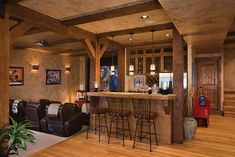 I dream of having a basement like this with like a mini kitchen/wet bar. I don't know about the theater set up though.