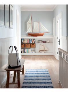 I want a beach house someday, in the off-chance that we don't end up with our primary residence on the beach. I love the feel of this entry way - and the sailboat is beautiful. #beach #houses #interiors