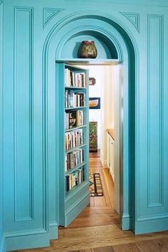 15 Lovely Libraries in Unexpected Places // secret bookcase, doorway library