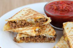 Beefy quesadillas! These quesadillas use a burrito-style filling which consists of taco seasoned ground beef, refried beans, and green chilies. You can use whatever type of cheese you like but I prefer Mexican cheese blend. These quesadillas go great served with salsa, guacamole, and sour cream. If you are looking for a dinner that is very easy to prepare, this is the one! Enjoy.