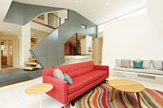 The stair comes in for a landing somewhat like a spaceship, a modern centerpiece in the home.