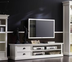 this large rustic white tv unit gives a fashionable nod towards shabby chic